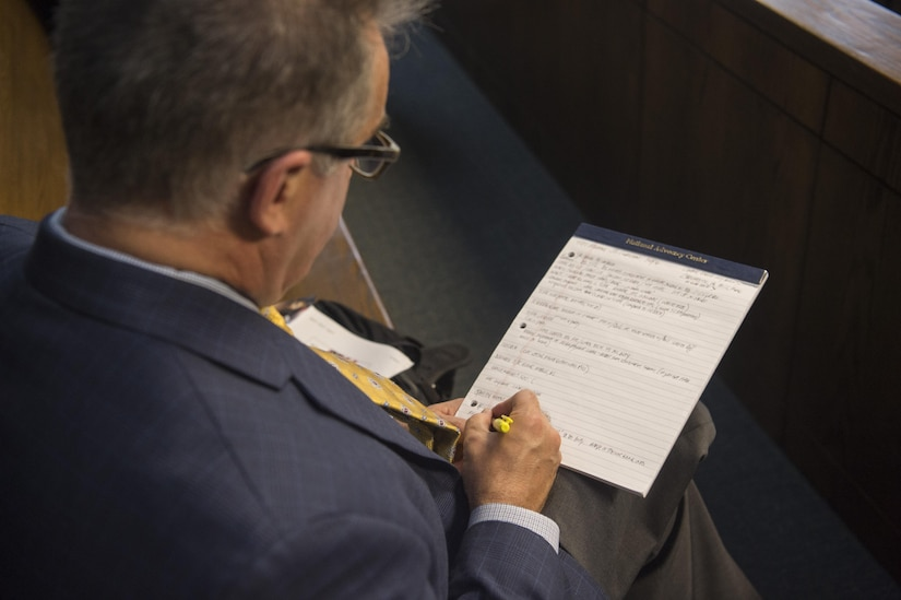 John Moran, Assistant Director of Training for the Department of Justice, takes notes during the multiservice DOJ conference here, Sept. 9, 2016. The training was held so judge advocates could help defend active duty, guardsmen, reservists and veterans alike under the Servicemembers Civil Relief Act and the Uniformed Services Employment and Reemployments Rights Act. These laws help protect them from negative treatment from their employers due to their service.