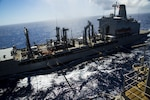 AT SEA -- The USS Bonhomme Richard (LHD-6) refuels and receives supplies during a replenishment at sea in the Pacific Ocean, Sept. 12, 2016. During replenishments at sea, Navy MH-60S Seahawk helicopters ferry food and supplies from Navy supply ships to the ships of the Bonhomme Richard Expeditionary Strike Group. The 31st MEU is the Marine Corps' only continuously forward-deployed Marine Air-Ground Task Force, and combines air-ground-logistics into a single team capable of addressing a range of military operations in the Asia-Pacific region – from force protection and maritime security to humanitarian assistance and disaster relief in cooperation with host countries and partner militaries.