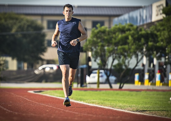 Master Sgt. Tito Carrillo, 433rd Aeromedical Evacuation Squadron flight medic, paces himself as he begins a two-mile speed run Sept. 1, 2016 at Joint Base San Antonio-Lackland, Texas. Carrillo was selected to run on the 2016 Air Force Reserve Command's Challenge Team. The team is comprised of ten marathon runners who will compete with other Air Force major commands in the half and full marathon at the 20th annual Air Force Marathon Sept. 17, 2016 at Wright-Patterson Air Force Base, Ohio.  (U.S. Air Force photo by Benjamin Faske)