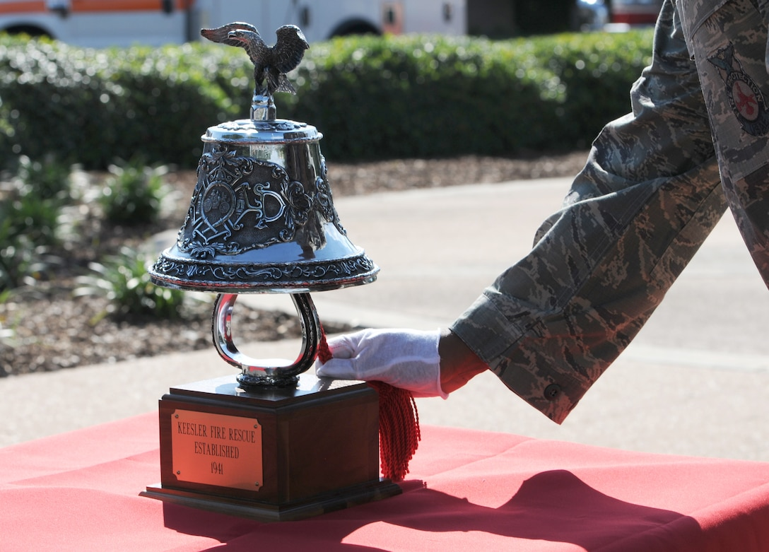 Staff Sgt. Anthony Marshall, 81st Infrastructure Division firefighter, conducts a last alarm tribute during a 9/11 memorial retreat ceremony, Sept. 12, 2016, on Keesler Air Force Base, Miss. Fifteen years ago on Sept. 11, 2001, 19 terrorists simultaneously hijacked four passenger jets; flying one into the Pentagon and two into the World Trade Center in New York City, N.Y., and one crashing outside of Shanksville, Pa. A total of 2,996 people were killed in the attacks. (U.S. Air Force photo by Kemberly Groue/Released)