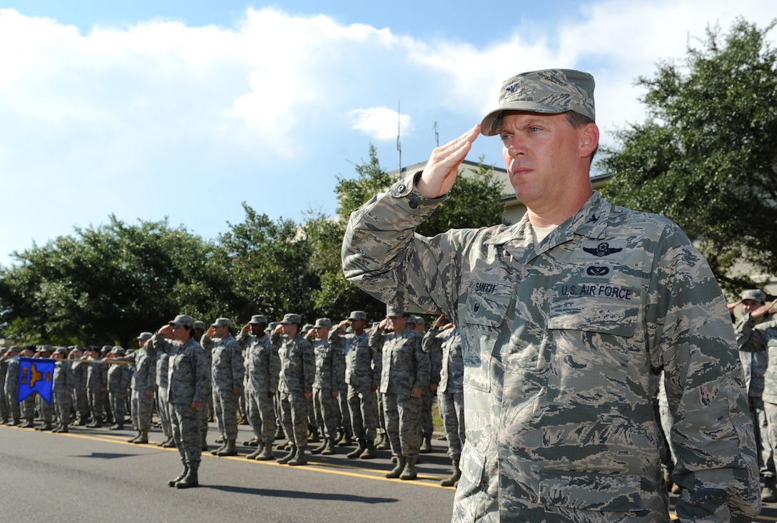 Col. C. Mike Smith, 81st Training Wing vice commander, renders a salute during a 9/11 memorial ceremony, Sept. 12, 2016, on Keesler Air Force Base, Miss. Fifteen years ago on Sept. 11, 2001, 19 terrorists simultaneously hijacked four passenger jets; flying one into the Pentagon in Washington, D.C., two into the World Trade Center in New York City, New York and one crashing outside of Shanksville, Pa. A total of 2,996 people were killed in the attacks.  (U.S. Air Force photo by Kemberly Groue/Released)