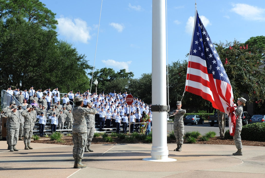 Keesler personnel lower the U.S. flag during a 9/11 memorial ceremony, Sept. 12, 2016, on Keesler Air Force Base, Miss. Fifteen years ago on Sept. 11, 2001, 19 terrorists simultaneously hijacked four passenger jets; flying one into the Pentagon in Washington, D.C., two into the World Trade Center in New York City, New York and one crashing outside of Shanksville, Pa. A total of 2,996 people were killed in the attacks.  (U.S. Air Force photo by Kemberly Groue/Released)