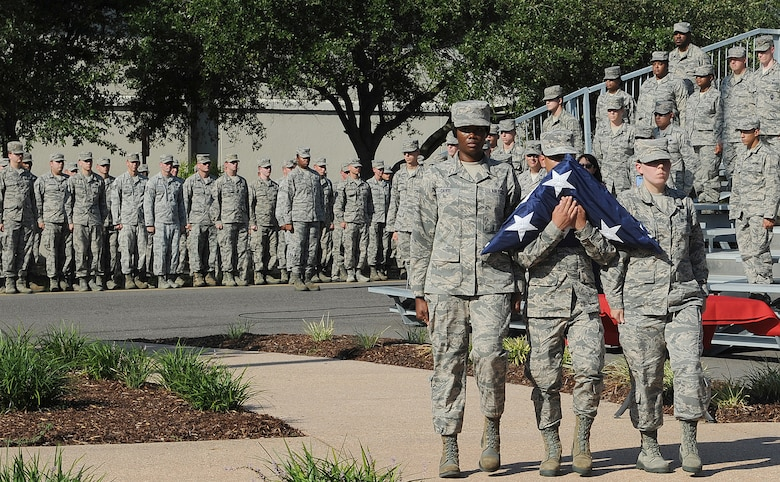 Tech. Sgt. Amber Davis, 81st Diagnostic and Therapeutics Squadron radiology technician  and Airmen 1st Class Devon Montoya81st, and Ashley Kennedy, 81st MDTS radiology technicians, carry the U.S. flag during a 9/11 memorial ceremony, Sept. 12, 2016, on Keesler Air Force Base, Miss. Fifteen years ago on Sept. 11, 2001, 19 terrorists simultaneously hijacked four passenger jets; flying one into the Pentagon in Washington, D.C., two into the World Trade Center in New York City, New York and one crashing outside of Shanksville, Pa. A total of 2,996 people were killed in the attacks.  (U.S. Air Force photo by Kemberly Groue/Released)