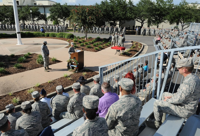 Col. Michele Edmondson, 81st Training Wing commander, delivers remarks during a 9/11 memorial ceremony, Sept. 12, 2016, on Keesler Air Force Base, Miss. Fifteen years ago on Sept. 11, 2001, 19 terrorists simultaneously hijacked four passenger jets; flying one into the Pentagon in Washington, D.C., two into the World Trade Center in New York City, New York and one crashing outside of Shanksville, Pa. A total of 2,996 people were killed in the attacks.  (U.S. Air Force photo by Kemberly Groue/Released)