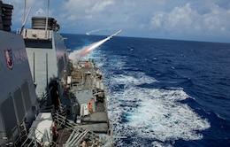 The Arleigh Burke-class guided-missile destroyer USS Benfold (DDG 65) conducts a live fire of a harpoon missile, with the Arleigh Burke-class guided-missile destroyer USS John S. McCain (DDG 56), as part of a sink exercise (SINKEX) during Valiant Shield, Sept. 13, 2016.  Valiant Shield is a biennial, U.S. only, field-training exercise with a focus on integration of joint training among U.S. forces. This is the sixth exercise in the Valiant Shield series that began in 2006. Benfold is on patrol with Carrier Strike Group Five in the Philippine Sea supporting security and stability in the Indo-Asia-Pacific region.