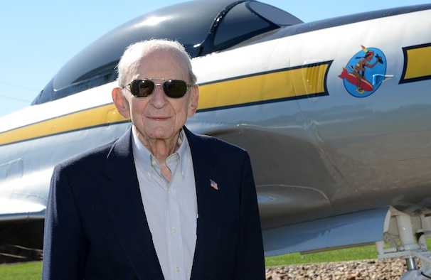 "World War II Veteran and former Air National Guard Wing Commander, Col. Warren ""Bud"" Nelson (Ret.), stands in front of a U.S. Air Force F-80 Shooting Star, he once piloted as a member of the Iowa Air National Guard. Nelson is visiting his old unit, the 185th Air Refueling Wing, during a 70th anniversary open house event in Sioux City, Iowa on September 10, 2016.