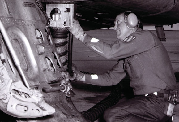 """188th Tactical Fighter Group Airman provides maintenance to an F-100 """"Super Sabre"""" during Bold Eagle in 1976. (Courtesy photo)"""