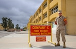 Marine Corps Lance Cpl. Stephen J. Bayer, Charlie Company, 1st Recruit Training Battalion, stands outside his squad bay at Marine Corps Recruit Depot San Diego, Sept. 12, 2016. Bayer spent an extra three months at the depot while waiting for an injury to heal. Following recruit training, Bayer will report to infantry school at Camp Pendleton, Calif., and then on to his military occupational specialty school to become a military policeman. Marine Corps photo by Cpl. Angelica Annastas