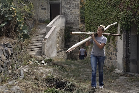 Cpl. Jessica Lucy, a combat engineer with Special Purpose Marine Air-Ground Task Force Crisis Response-Africa, carries fence posts up a hill in Vizzini, Sicily, Sept. 7, 2016.  Marines volunteered to clean up a local historic site and build fences during a community relations project.  (U.S. Marine Corps photo by Cpl. Alexander Mitchell/released)