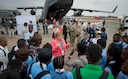 Ms. Heidi Grant, deputy under secretary for international affairs, speaks to a group of South African students who were touring U.S. military aircraft at the African Aerospace and Defense Expo at Waterkloof Air Force Base, South Africa, Sept. 14, 2016. The U.S. military is exhibiting a C-17 Globemaster III, a KC-135 Stratotanker, a C-130J Super Hercules, an HC-130 King, and an MQ-9 Reaper. The aircraft come from various Air National Guard and Air Force Reserve Command units. The U.S. routinely participates in events like AADE to strengthen partnerships with regional partners. (U.S. Air Force photo by Tech. Sgt. Ryan Crane)