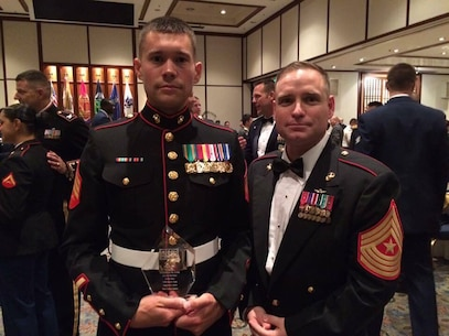 U.S. Marine Corps Sgt. Johnathan M. Cobb, left, patrol supervisor for the Provost Marshal's Office at Marine Corps Air Station Iwakuni, and U.S. Marine Corps Sgt. Major Christopher J. Garza, station sergeant major, pose for a photo at the USO Japan Ninth Annual Service Salute Gala in Tokyo, Japan, Aug. 27, 2016. Cobb exceeded all criteria and represented MCAS Iwakuni at the Service Salute Gala as the air station's Marine of the year. (U.S. Marine Corps courtesy photo)