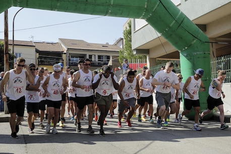 Marines with Special Purpose Marine Air-Ground Task Force Crisis Response-Africa start to run at the beginning of a race in Nissoria, Sicily, Sept. 11, 2016.  Marines and locals ran a 5-kilometer race through the streets of the town to honor the lives lost on Sept. 11, 2001.  (U.S Marine Corps photo by Cpl. Alexander Mitchell/released)