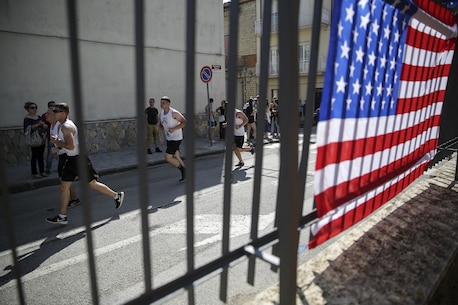 Marines with Special Purpose Marine Air-Ground Task Force Crisis Response-Africa take the final turn on a run in Nissoria, Sicily, Sept. 11, 2016.  Marines and locals ran a 5-kilometer race through the streets of the town to honor the lives lost on Sept. 11, 2001.  (U.S Marine Corps photo by Cpl. Alexander Mitchell/released)
