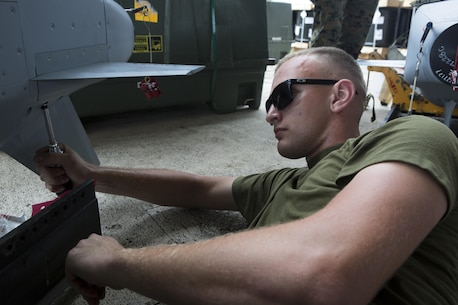 U.S. Aviation Ordnance Marines with Marine Aviation Logistics Squadron12 prepare ordnance for aviation squadrons participating in Valiant Shield 16 at Andersen Air Force Base, Guam, September 12, 2016. The ordnance constructed, provided the Marines of MALS-12 valuable experience assembling live ordnance to be used  during VS16 for a ship sinking exercise. VS16 is a biennial U.S. only, field training exercise that focuses on joint training with U.S. Navy, Air Force and Marine Corps to increase interoperability and working relationships. (U.S. Marine Corps photo by Sgt. Justin A. Fisher)