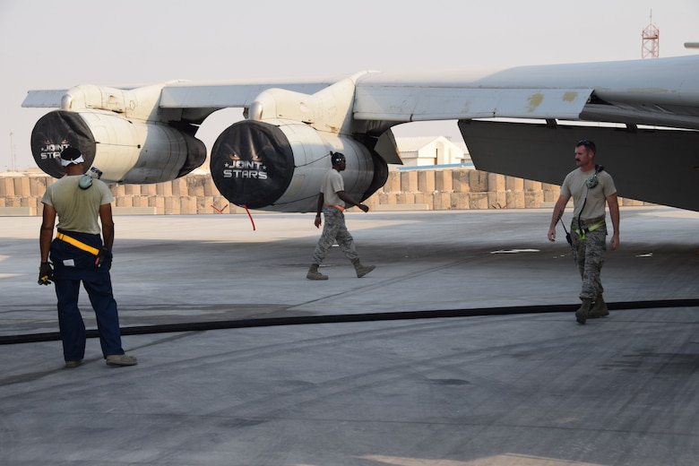 Crew chiefs from the 7th Expeditionary Air Mobility Unit prepare to load fuel onto a E-8C Joint Surveillance Target Attack Radar System prior to a mission on Sept. 12, 2016, at Al Udeid Air Base, Qatar. The crew chiefs from the 7th Expeditionary Air Mobility Unit are deployed here from Robins Air Force Base, Ga. NCO in charge Senior Master Sgt. Frederick Mabry (center), Staff Sgts. Michael Edwards (left) and Dustin Miller(right) prepared the JSTARS for a combat mission later on that evening. (U.S. Air Force photo/Tech. Sgt. Carlos J. Trevino/Released)