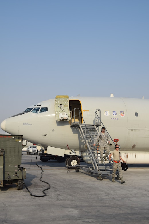 Crew chiefs from the 7th Expeditionary Air Mobility Unit exit a E-8C Joint Surveillance Target Attack Radar System prior to a mission on Sept. 12, 2016, at Al Udeid Air Base, Qatar. The JSTARS uses its communicaiton and radar systems support ground units and direct air support throughout the area of responisbility. (U.S. Air Force photo/Tech. Sgt. Carlos J. Trevino/Released)