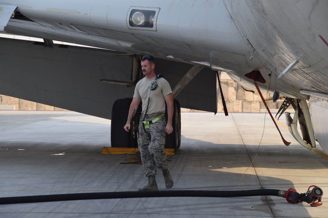 Staff Sgt. Dustin Miller, a crew chief deployed here from Robins AirForce Base, Ga., rom the 7th Expeditionary Air Mobility Unit prepares a fuel line to load a E-8C Joint Surveillance Target Attack Radar System prior to a mission on Sept. 12, 2016, at Al Udeid Air Base, Qatar. JSTARS aircrew report the information they collect to theater ground and air commanders to ensure coalition forces have real-time data in support on the war on terror. (U.S. Air Force photo/Tech. Sgt. Carlos J. Trevino/Released)