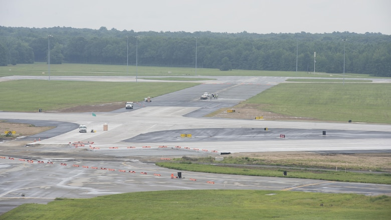 The intersection of Runway 01-19 and Runway 14-32 is under construction Sept. 1, 2016, on Dover Air Force Base, Del. Dover's shorter Runway 14-32 will be closed to allow construction on a portion in close proximity to runway 01-19, and in addition, several taxiways. This portion of construction is anticipated for completion in summer 2017. (U.S. Air Force photo by Senior Airman Zachary Cacicia)