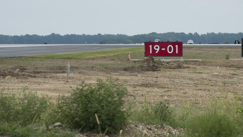 An airfield sign marking Runway 01-19 sits at its intersection with Runway 14-32 Sept. 1, 2016, on Dover Air Force Base, Del. Runway 01-19 is expected to open for operation Sept. 23, 2016. (U.S. Air Force photo by Senior Airman Zachary Cacicia)