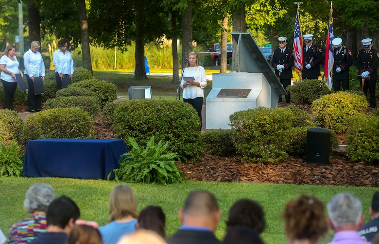 Members of the community bow their heads for a moment of silence in remembrance for the victims of the Sept. 11, 2001 attacks during the Patriot Day Observance Ceremony at the Lejeune Memorial Gardens on Marine Corps Base Camp Lejeune, Sept. 11, 2016. The community stood together to remember the victims of the Sept. 11, 2001 terrorist attacks during the 15 year anniversary.