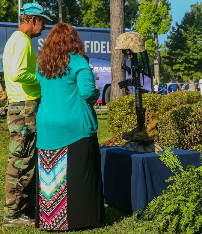 Two members of the Jacksonville community pay their respect to the representation of fallen Marines in the aftermath of the Sept. 11, 2001 attacks at the Lejeune Memorial Gardens during the Patriot Day Observance Ceremony on Marine Corps Base Camp Lejeune, Sept. 11, 2016. The community stood together to remember the victims of the Sept. 11, 2001 terrorist attacks during the 15 year anniversary.