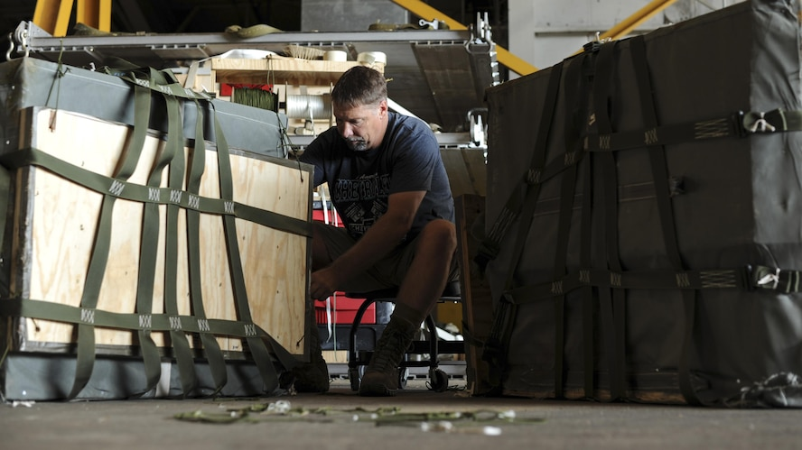 Kevin Williams, a 19th Logistics Readiness Squadron Aerial Delivery parachute rigger, prepares cargo bundles Sept. 8, 2016, at Hangar 259 on Little Rock Air Force Base, Ark. The aerial delivery team trains at three separate drops zones in Arkansas, operating year-round to ensure the Combat Airlift mission is achieved year-round.