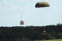Parachutes deliver cargo platforms to ground forces Sept. 12, 2016, at a drop zone in central Arkansas. Each parachute must be checked for holes or broken lines prior to use.