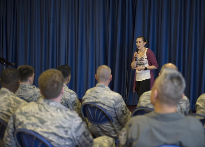 U.S. Air Force Staff Sgt. Julie Stich, 48th Medical Group radiology technician and Green Dot implementer, speaks to Airmen during a Green Dot general overview training at Royal Air Force Lakenheath, England, Sept. 9. The training revolves around teaching Airmen how to recognize, analyze and respond to an incident involving interpersonal violence. (U.S. Air Force photo/Senior Airman Malcolm Mayfield)