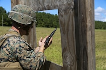 Cpl. Joshua Hodel, Stone Bay target shed noncommissioned officer in charge, conducts a speed reload with the M9 service pistol Combat Marksmanship Trainer Course were tested on coordinating a 3-gun shooting competition at Stone Bay on Marine Corps Base Camp Lejeune, Sept. 1. The competition enabled CMT students to become familiar with how to set up and run a range and range personnel were also able to hone their marksmanship skills. (U.S. Marine Corps photo by Cpl. Mark Watola /Released)