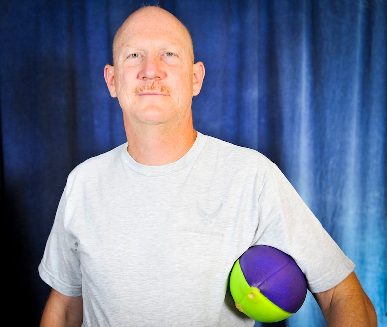 Master Sgt. Brian, 22nd Intelligence Squadron, holds a football September 9, 2016 at Fort Meade, Md. Brian, who is the last active-duty Airman to compete in all 19 U.S. Air Force Marathons, uses a football to entertain himself and others during the marathon. Brian will be competing in the 20th AF Marathon, which will be held on September 17, 2016 at Wright-Patterson Air Force Base, Ohio. (U.S. Air Force photo/Staff Sgt. AJ Hyatt)