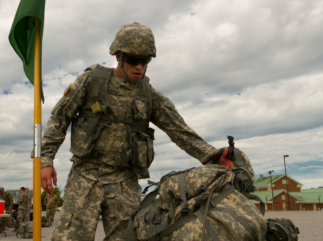 Spc. McKeever, John, a U.S. Army Reserve Soldier with the 200th Military Police Command, takes off his ruck sack after finishing a ruck march on Fort Meade, Md., Sept. 11. The march was five miles long and each of the Soldiers were required to carry a ruck that weighed at least 35 pounds.  (U.S. Army Reserve photo by Sgt. Audrey Hayes)