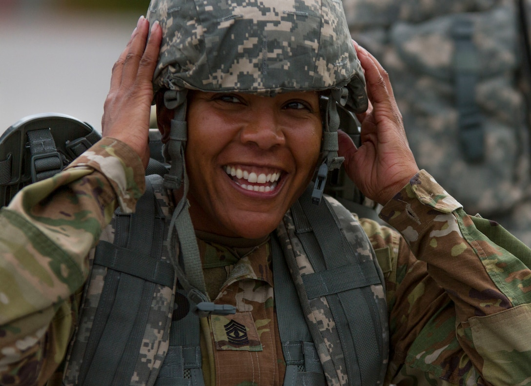 1st. Sgt. Tomeka Johnson, the senior enlisted leader for the Headquarters Company with the 200th Military Police Command, takes off her helmet after finishing a ruck march on Fort Meade, Md., Sept. 11. The march was five miles long and each of the Soldiers were required to carry a ruck that weighed at least 35 pounds.  (U.S. Army Reserve photo by Sgt. Audrey Hayes)