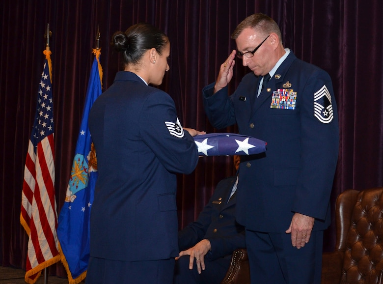 Chief Master Sgt. Phil Roe salutes the American flag during his retirement ceremony Sept. 10, 2016 at Patrick Air Force Base, Fla. Roe served in the 920th Rescue Wing and its predecessor squadron for 26 of his 36 years in the Air Force. (U.S. Air Force photo by 1st Lt. Anna-Marie Wyant)