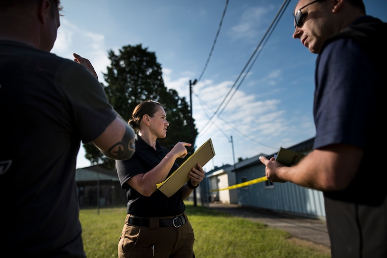 U.S. Army special agent Nikki Drury, with the Fort Meade Criminal Investigation Division Office in Maryland, points to a crime scene during Capital Shield 2016 at Fort Belvoir, Virginia, Sept. 13. Approximately 15 U.S. Army Reserve criminal investigative special agents trained alongside 25 active duty agents for the first time in a joint training exercise known as Capital Shield, focusing on crime scene processing, evidence management and hostage negotiations, Sept. 13-15. The reserve Soldiers participating in this year's Capital Shield are agents from the 733rd Military Police Battalion (Criminal Investigation Division), headquartered in Fort Gillem, Georgia, which reports to the 200th Military Police Command. The active duty agents belong to various offices across the Washington CID Battalion, headquartered at Fort Myer, Virginia. (U.S. Army Reserve photo by Master Sgt. Michel Sauret)