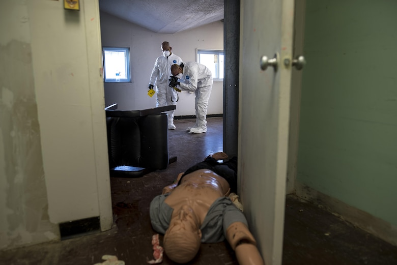 Two U.S. Army special agents process a crime scene during Capital Shield 2016 at Fort Belvoir, Virginia, Sept. 13. Approximately 15 U.S. Army Reserve criminal investigative special agents trained alongside 25 active duty agents for the first time in a joint training exercise known as Capital Shield, focusing on crime scene processing, evidence management and hostage negotiations, held Sept. 13-15. The reserve Soldiers participating in this year's Capital Shield are agents from the 733rd Military Police Battalion (Criminal Investigation Division), headquartered in Fort Gillem, Georgia, which reports to the 200th Military Police Command. The active duty agents belong to various offices across the Washington CID Battalion, headquartered at Fort Myer, Virginia. (U.S. Army Reserve photo by Master Sgt. Michel Sauret)