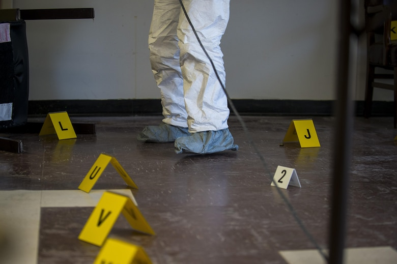 A U.S. Army criminal investigation special agent measures the length of a room during Capital Shield 2016 at Fort Belvoir, Sept. 13. Approximately 15 U.S. Army Reserve criminal investigative special agents trained alongside 25 active duty agents for the first time in a joint training exercise known as Capital Shield, focusing on crime scene processing, evidence management and hostage negotiations, held Virginia, Sept. 13-15. The reserve Soldiers participating in this year's Capital Shield are agents from the 733rd Military Police Battalion (Criminal Investigation Division), headquartered in Fort Gillem, Georgia, which reports to the 200th Military Police Command. The active duty agents belong to various offices across the Washington CID Battalion, headquartered at Fort Myer, Virginia. (U.S. Army Reserve photo by Master Sgt. Michel Sauret)