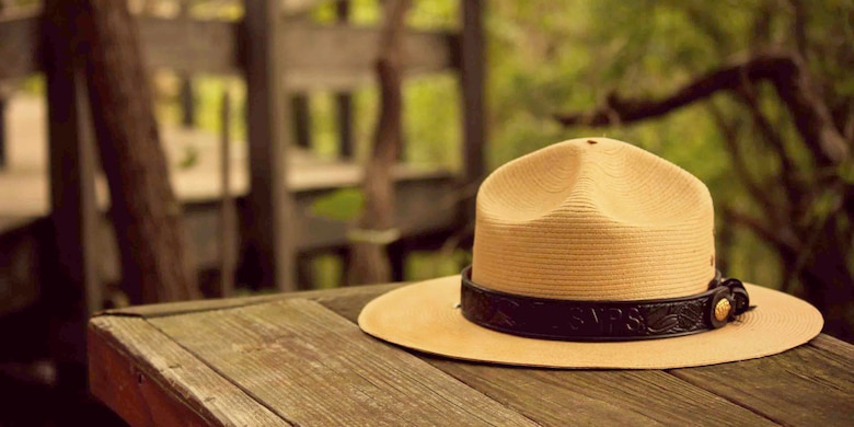 National Park Service Ranger Hat. The National Park Service hat band features leaves and the cone of the giant sequoia tree. Sequoia National Park is the second National Park established by law.
