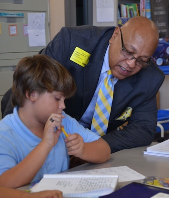 Ed Lee, program coordinator for historically black colleges, universities and minority-serving institutions, looks over classwork with Clayton Hovik, a 5th grader in Stephanie Lay's science class at Endeavour Elementary School in Cocoa Fla., Sept. 7, 2016.  Lee visited the Title I facility to observe the partnership between the school and the Air Force Technical Applications Center, Patrick AFB, Fla.  (U.S. Air Force photo by Susan A. Romano)