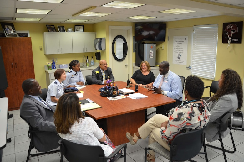 Rachad Wilson (right, in light blue), principal of Endeavour Elementary School, Cocoa, Fla., discusses the community school program with Dr. Jarris L. Taylor Jr.,  Deputy Assistant Secretary of the Air Force for Strategic Diversity Initiative, Sept. 7, 2016.  Taylor and members of his staff were in town for the Women in Science and Engineering Symposium hosted by the Air Force Technical Applications Center at Patrick AFB, Fla., which is also a community partner with the local elementary school.  Also pictured starting from bottom left to right:  Doreen Carlo-Coryell, Endeavour's assistant principal; Michele Scott, planning director for Children's Home Society; Rose Day, AFTAC's human resources program manager; Wilson, Christy Meraz, Endeavour's assistant principal; Ed Lee, program coordinator for historically black colleges and minority institutions; Maj. Denisha Darcus and Col. Angela Giddings, both with the Air Force Diversity and Inclusion office; and Taylor.  (U.S. Air Force photo by Susan A. Romano)