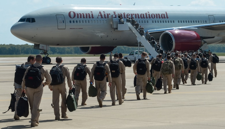 Barksdale Airmen board a plane to deploy from Barksdale Air Force Base, La., Sept. 10, 2016. More than 350 Barksdale Airmen deployed to Al Udeid Air Base, Qatar, from Sept. 6-10 in support of Operation Inherent Resolve. The mission of OIR is to defeat DA'ESH, the terrorist organization commonly referred to as ISIS, to increase regional stability. (U.S. Air Force photo/Senior Airman Curt Beach)