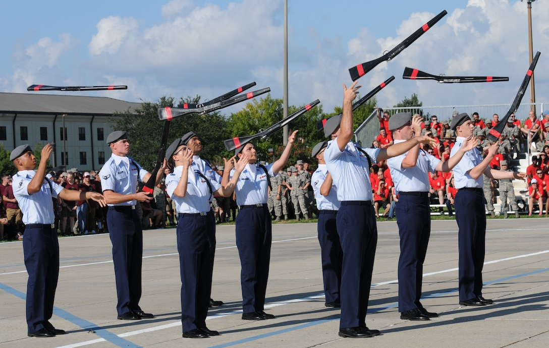 """Members of the 335th Training Squadron freestyle drill team perform during the 81st Training Group drill down at the Levitow Training Support Facility drill pad Sept. 9, 2016, on Keesler Air Force Base, Miss. The 335th TRS """"Bulls"""" placed second overall. (U.S. Air Force photo by Kemberly Groue/Released)"""