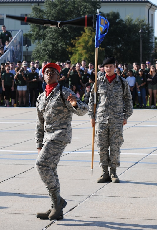 """Airmen 1st Class Derrick Notice, and Nicholas Scoggins, 336th Training Squadron freestyle drill team members, perform during the 81st Training Group drill down at the Levitow Training Support Facility drill pad Sept. 9, 2016, on Keesler Air Force Base, Miss. The 336th TRS """"Red Wolves"""" placed first in freestyle and third in regulation and overall. (U.S. Air Force photo by Kemberly Groue/Released)"""