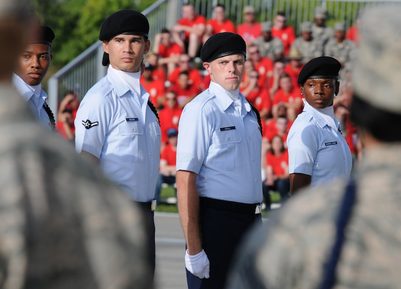 """Members of the 334th Training Squadron regulation drill team perform during the 81st Training Group drill down at the Levitow Training Support Facility drill pad Sept. 9, 2016, on Keesler Air Force Base, Miss. The 334th TRS """"Gators"""" placed first in open ranks, regulation and overall. (U.S. Air Force photo by Kemberly Groue/Released)"""