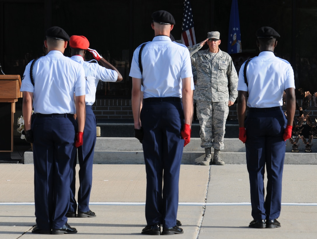 "Chief Master Sgt. Robert Winters, 81st Training Group superintendent, renders a salute to the 336th Training Squadron regulation drill team during the 81st Training Group drill down at the Levitow Training Support Facility drill pad Sept. 9, 2016, Keesler Air Force Base, Miss. This was his last drill down as the 81st TRG superintendent before retiring with 29 years of service later that day. The 336th TRS ""Red Wolves"" placed first in freestyle and third in regulation and overall. (U.S. Air Force photo by Kemberly Groue/Released)"