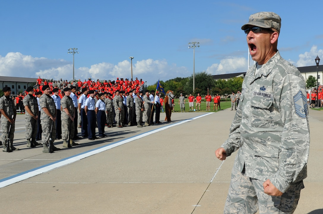"""Chief Master Sgt. Robert Winters, 81st Training Group superintendent, yells a chant during the 81st Training Group drill down at the Levitow Training Support Facility drill pad Sept. 9, 2016, on Keesler Air Force Base, Miss. This was his last drill down as the 81st TRG superintendent before retiring with 29 years of service. The 334th TRS """"Gators"""" placed first in open ranks, regulation and overall. (U.S. Air Force photo by Kemberly Groue/Released)"""