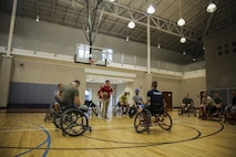Marines with Wounded Warrior Battalion – East and Danish army wounded warriors, learn how to play wheelchair basketball at Wallace Creek Fitness Center on Marine Corps Base Camp Lejeune, Sept. 13. The two units together for a luncheon and two days full of competition and bonding on Marine Corps Base Camp Lejeune on Sept. 12-13. (U.S. Marine Corps photo by Lance Cpl. Sean J. Berry