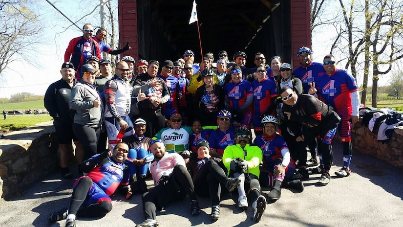 The Warriors4Life team stops to take a group photo during their two-day, 110-mile Face of America bike ride from Arlington, Va., to Gettysburg, Pa., April 25-26, 2015. More than 150 disabled veteran cyclists and 600 able-bodied cyclists participated in the annual World T.E.A.M. Sports event. Throughout the event, each cyclist helped each other along the course. Courtesy photo