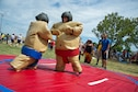459th Air Refueling Wing dependents go head-to-head in a sumo wrestling challenge during Family Day at Joint Base Andrews, Maryland, Sunday, Sept. 11, 2016. The annual event featured food, sumo wrestling, volleyball, dunk tank, children's obstacle course, softball jump castle, photo booth and much more. (U.S. Air Force photo/Staff Sgt. Kat Justen)