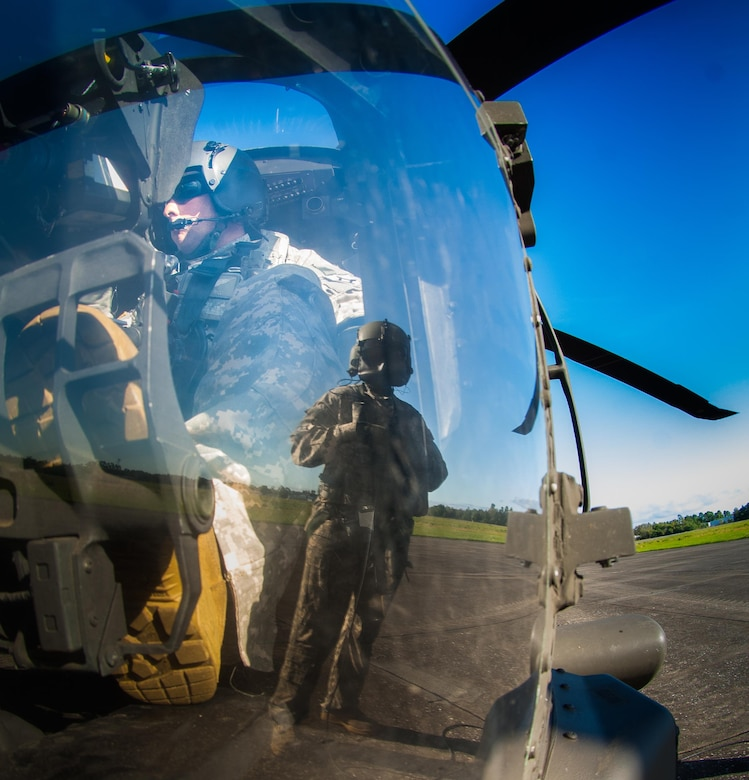 U.S. soldiers, assigned to Special Operations Detachment - C, conduct airborne operations from a UH-60 Black Hawk helicopter piloted by a Florida National Guard helicopter crew in Brooksville, Fla., April 23, 2016. Army photo by Ching Oettel
