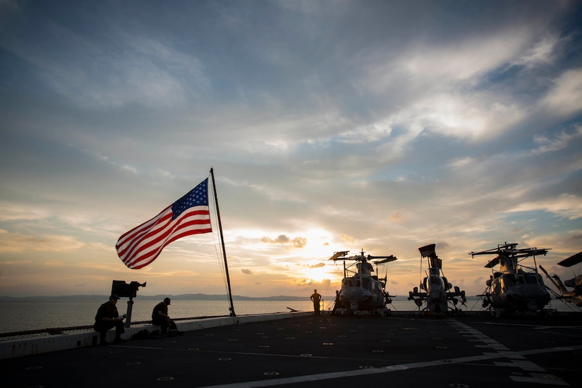 The sun sets over the USS Green Bay at White Beach Naval Base, Okinawa, Japan, Aug. 21, 2016. Marines of the 31st MEU are embarked on ships of the USS Bonhomme Richard Expeditionary Strike Group for a scheduled fall patrol of the Asia-Pacific Region. The 31st MEU is the Marine Corps' only continuously forward-deployed Marine Air-Ground Task Force, and is task-organized to address a range of military operations in the Asia-Pacific region, from force projection and maritime security to humanitarian assistance and disaster relief. Marine Corps photo by Cpl. Darien J. Bjorndal